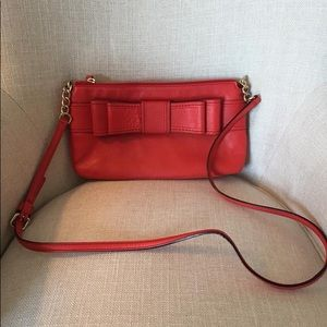 Authentic Kate Spade red leather cross body purse.
